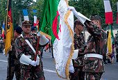 Algerian soldiers prepare before they parade on July 12 2014 on the Champs Elysees avenue in Paris during a rehearsal of the French national...