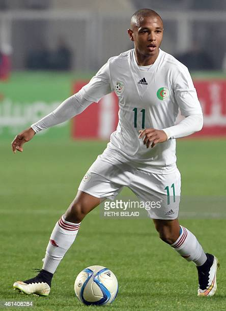 Algerian striker Yacine Brahimi controls a ball during a friendly soccer match between Tunisia and Algeria on January 11 2015 at Rades Olympic...