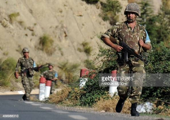 Algerian troops conduct a search operation on October 10 near the village of Ait Ouabane 80 kilometres south of Tizi Ouza for the body of 55year old...