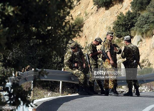 Algerian troops rest as they conduct a search operation on October 10 near the village of Ait Ouabane 80 kilometres south of Tizi Ouza for the body...