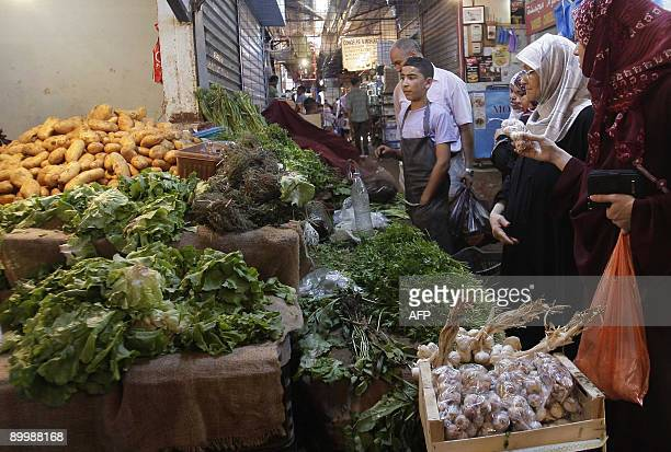 Algerian women buy vegetables at a popular market in Ain Benian suburb on August 21 2009 in Algiers before the start of Ramadan Algerians spend a...