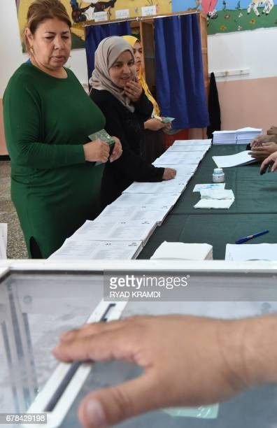 CORRECTION Algerian women cast their votes at a polling station in Algiers on May 4 2017 during parliamentary elections Algerians voted for a new...