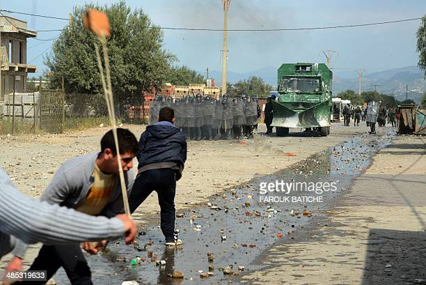 Algerian youths from the Kabyle ethnic group clash with security forces in Raffour some 130 km South East of the capital Algiers during a protest...