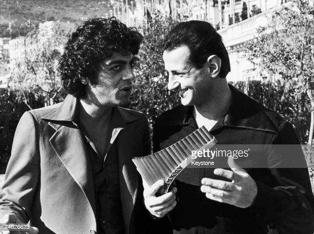 Algerianborn French singer Enrico Macias with Romanian pan flute virtuoso Gheorghe Zamfir in Monte Carlo 17th February 1976 Macias is in Monaco for...