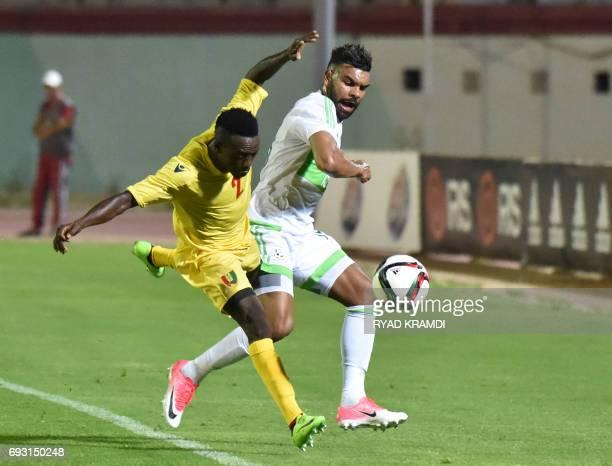 Algerian's El Arabi Hilal Soudani vies with Guinée's Bangoura Alseny during their friendly international football match between Algeria and Guinée at...