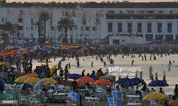JULIEN Algerians enjoy their time at a beach in Sidi Fredj a suburb of Algiers on August 21 2009 before the start of Ramadan Despite ongoing Islamist...