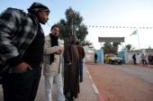 Algerians gather outside a hospital in In Amenas deep in the Sahara near the Libyan border on January 19 2013 Islamist gunmen killed seven foreign...