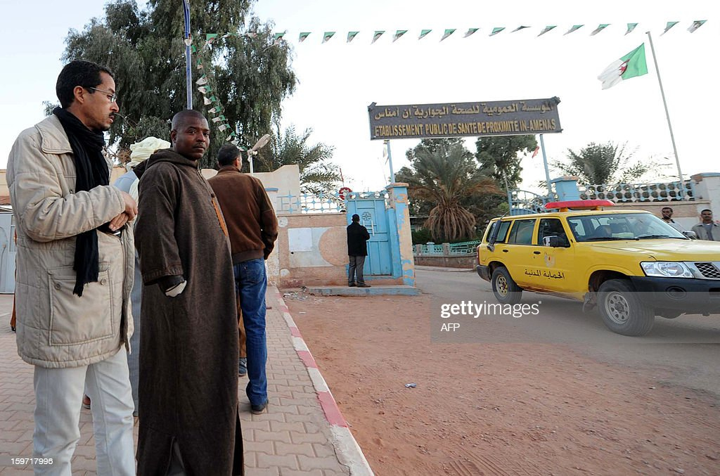 Algerians gather outside a hospital in In Amenas deep in the Sahara near the Libyan border on January 19, 2013. Islamist gunmen killed seven foreign hostages in Algeria before being gunned down by special forces in a final assault on a remote desert gas complex, state television said.