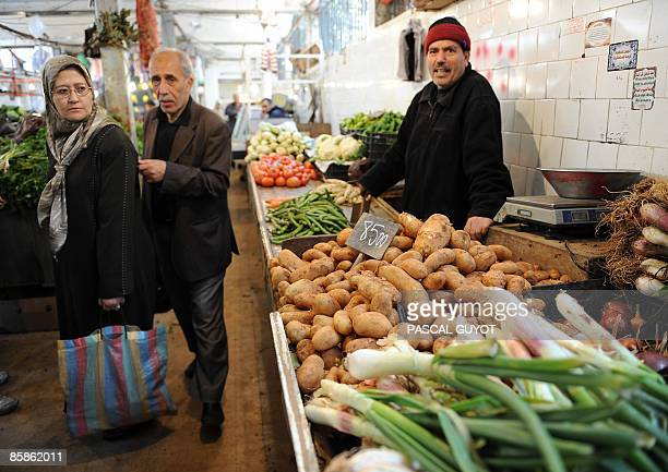Algerians look at the prices of vegetables at a market on April 8 2009 in Algiers on the eve of the presidential election The African Union will send...