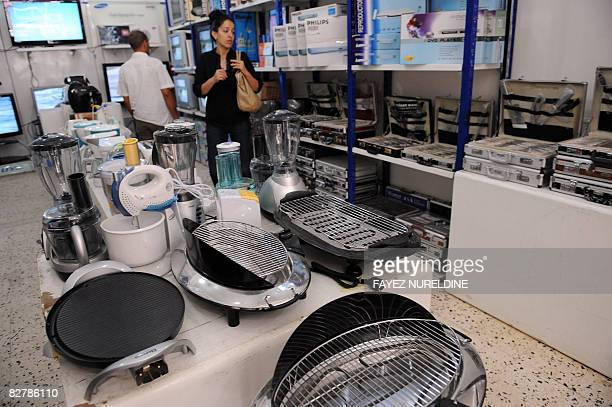 Algerians shop at an electronics store in the Hamiz market on September 11 in Algiers The El Hamiz neighborhood is one of the strongholds of the...