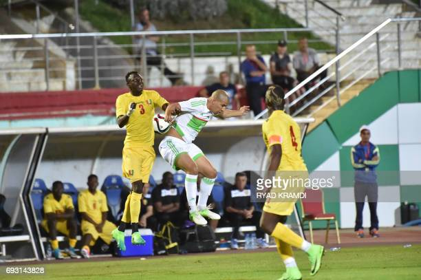 Algerian's Sofiane Feghouli vies with Guinée's Sylla Issiaga and Pogba Florantin during their friendly international football match between Algeria...