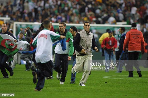 Algerian's team supporters invade the field during the friendly soccer match France vs Algeria at the Stade de France in SaintDenis 06 October 2001...