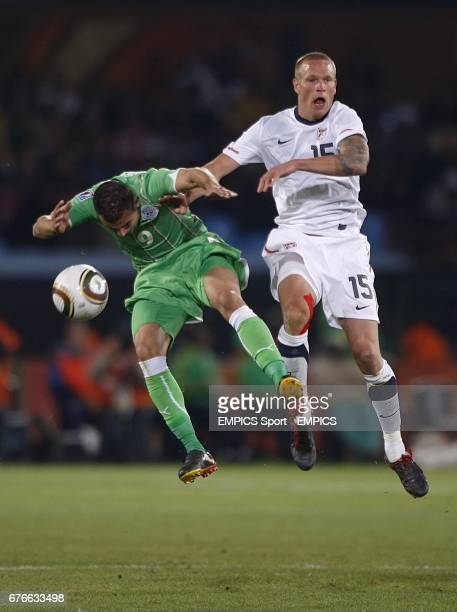 Algeria's Abdelkader Ghezzal and USA's Jay DeMerit battle for the ball in the air