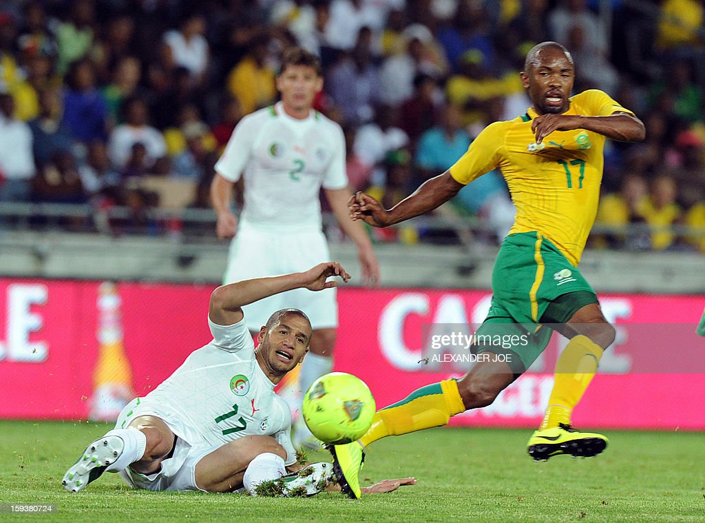 Algeria's Adlane Guedioura (L) looks on in front of South Africa's Bernard Parker during a friendly football match between South Africa's Bafana Bafana and Algeria in Soweto on January 12, 2013, ahead of the 2013 African Cup of nations that will take place in South Africa from January 19 to February 10.