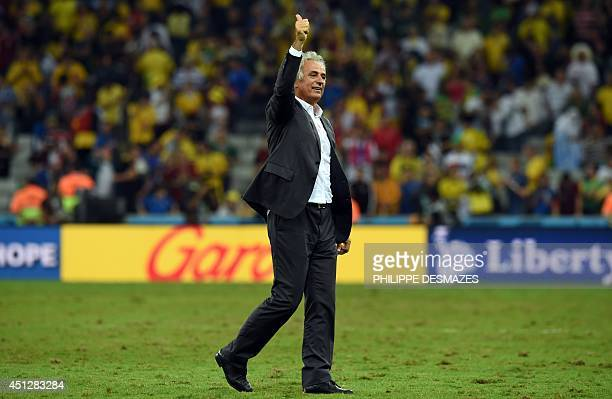 Algeria's Bosnian coach Vahid Halilhodzic gestures as he celebrates his team's victory in the Group H football match between Algeria and Russia at...
