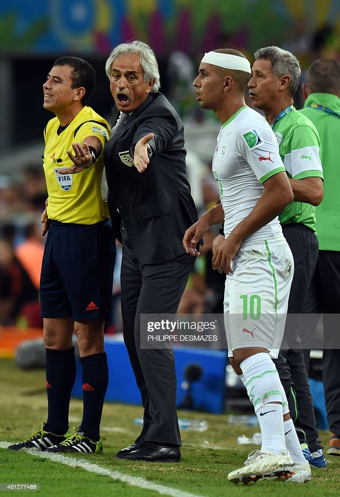 Algeria's Bosnian coach Vahid Halilhodzic (2L) gestures to the referee to let forward Sofiane Feghouli (2R) back onto the field after he had his head bandaged during the Group H football match between Algeria and Russia at The Baixada Arena in Curitiba on June 26, 2014, during the 2014 FIFA World Cup.