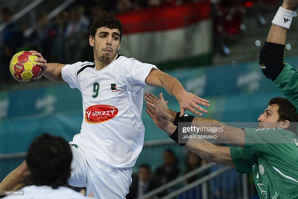 Algeria's centre back Abdelkader Rahim (L) shoots past Hungary's right wing Gergely Harsanyi during the 23rd Men's Handball World Championships preliminary round Group D match Hungary vs Algeria at the Caja Magica in Madrid on January 19, 2013.