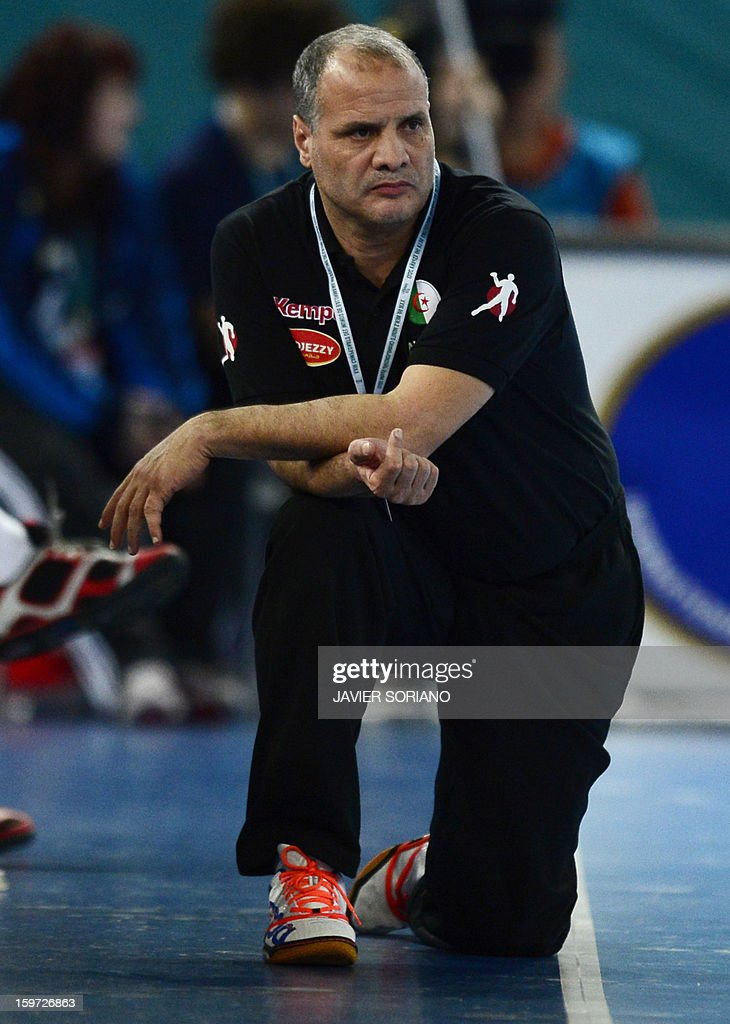 Algeria's coach Salah Bouchekriou looks on during the 23rd Men's Handball World Championships preliminary round Group D match Hungary vs Algeria at the Caja Magica in Madrid on January 19, 2013.