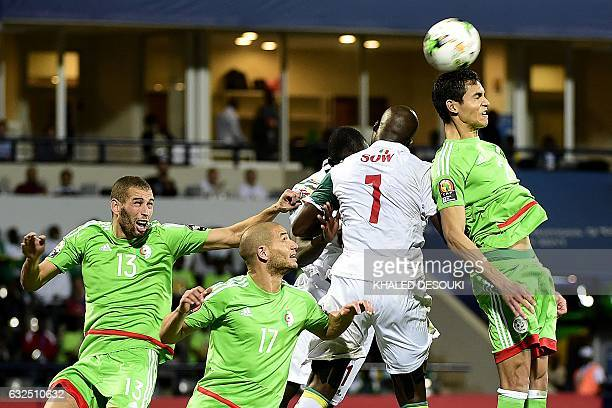 Algeria's defender Aissa Mandi heads the ball with Senegal's forward Moussa Sow next to Algeria's forward Islam Slimani and Algeria's midfielder...