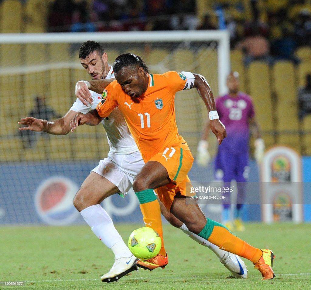 Algeria's defender Essaid Belkalem vies with Ivory Coast forward Didier Drogba (R) during a 2013 African Cup of Nations Group D football match in Rustenburg on January 30, 2013 at the Royal Bafokeng stadium.