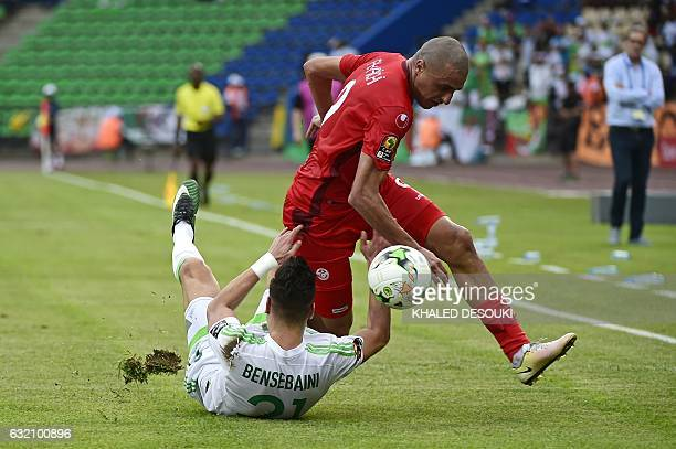 Algeria's defender Rami Bensebaini challenges Tunisia's forward Ahmed Akaichi during the 2017 Africa Cup of Nations group B football match between...