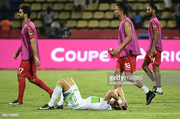 Algeria's defender Rami Bensebaini reacts at the end of the 2017 Africa Cup of Nations group B football match between Algeria and Tunisia in...