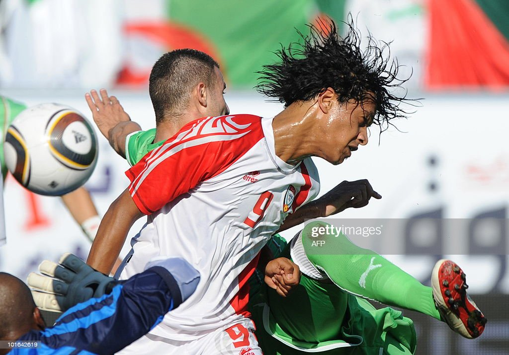 Algeria's Djebbour Rafik (back) and Emirates' Mohammed Al Shihi (front) challenge for the ball during a friendly football match between Algeria and the United Arab Emirates in Fuerth, southern Germany, June 5, 2010.