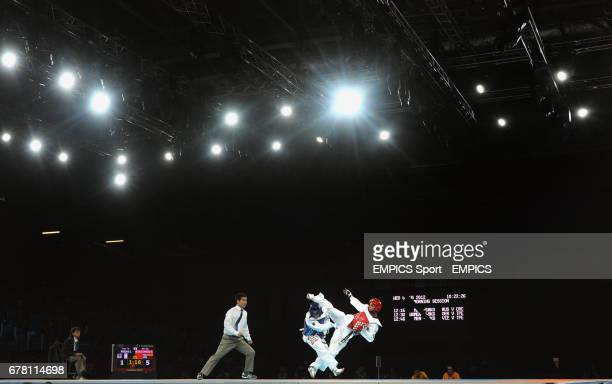 Algeria's ElYasmine Mokdad competes against Colombia's Oscar Munoz Oviedo during the Men's Taekwondo at the ExCel centre London