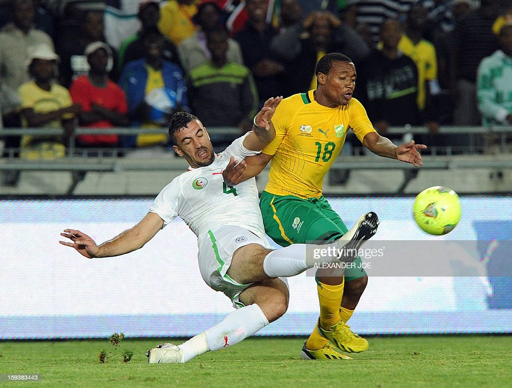 Algeria's Esseid Belkalem (L) vies with South Africa's Thuso Phala (R) during a friendly football match between South Africa's Bafana Bafana and Algeria in Soweto on January 12 , 2013, ahead of the 2013 African Cup of Nations that will take place in South Africa, from January 19 to February 10.