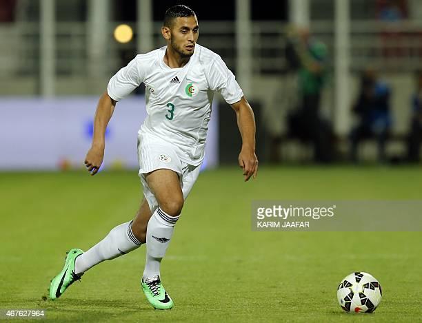 Algeria's Faouzi Ghoulam controls the ball during the friendly football match between Qatar and Algeria at Abdullah bin Nasser bin Khalifa Stadium in...