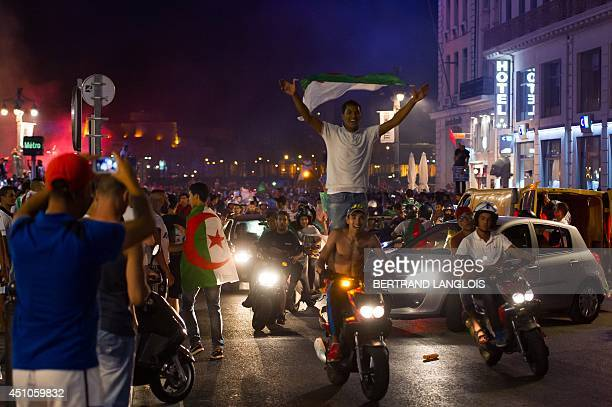 Algeria's football fans celebrate in Marseille southern France on June 22 2014 after Algeria defeated South Korea 42 in a FIFA 2014 World Cup Group H...