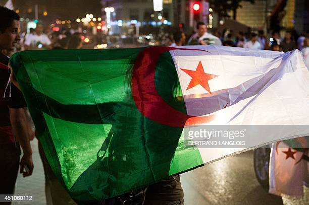 Algeria's football fans celebrate on the Canebiere in Marseille southern France on June 22 2014 after Algeria defeated South Korea 42 in a FIFA 2014...