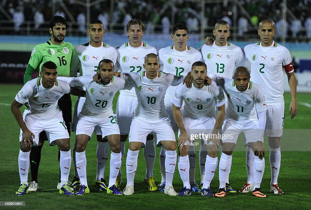 Algeria's football team player (front from L-R) Amine Zemmamouche, Faouzi Ghoulem, Mehdi Mostefa Sebaa, Carl Medjani, Islam Slimani, Madjid Boughera, (bottom from L-R) Hilal al-Arabi Soudani, Nacerdine Khouled, Sofien Feghouli, Mehdi Lacen, Yacine Brahimi pose for their picture prior to their World Cup qualifying match against Burkina Faso on November 19, 2013 in Blida, Algeria. Algeria sealed the fifth and final African zone World Cup qualifying berth, edging their play-off with Burkina Faso on away goals. Algeria got the goal they needed in the 49th minute through skipper Madjid Bougherra off a goal mouth scramble caused by a free-kick.