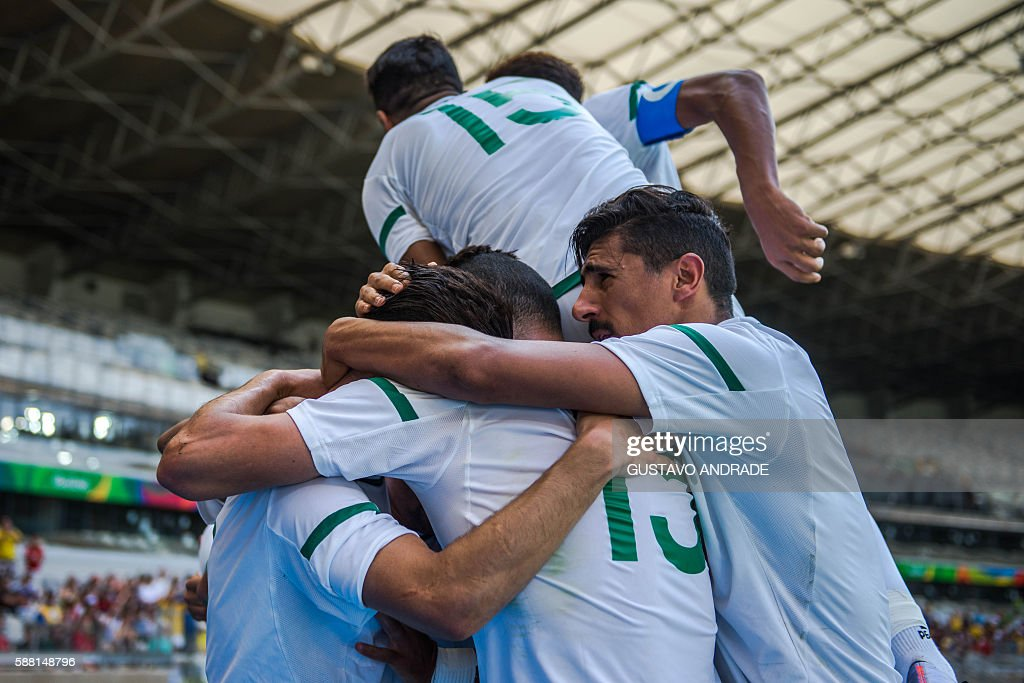 TOPSHOT Algeria's footballers celebrate the goal of Mohammed Benkablia during the Rio 2016 Olympic Games first round Group D men's football match...