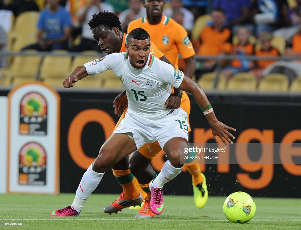 Algeria's forward Hilal Soudani (front) vies with Ivory Coast defender Ismael Traore during a 2013 African Cup of Nations Group D football match at the Royal Bafokeng Stadiumin in Rustenburg on January 30, 2013.