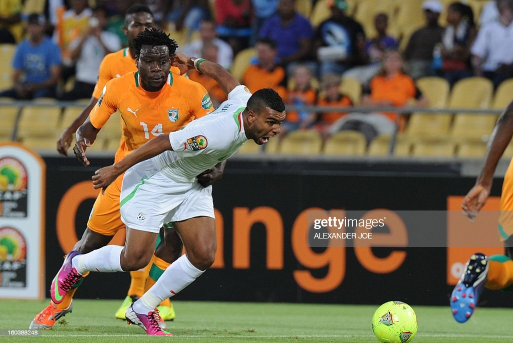 Algeria's forward Hilal Soudani (R) vies with Ivory Coast defender Ismael Traore during a 2013 African Cup of Nations Group D football match at the Royal Bafokeng Stadiumin in Rustenburg on January 30, 2013.