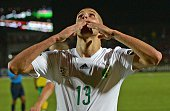 Algeria's forward Islam Slimani celebrates after scoring a goal during the 2015 African Cup of Nations group C football match between Algeria and...