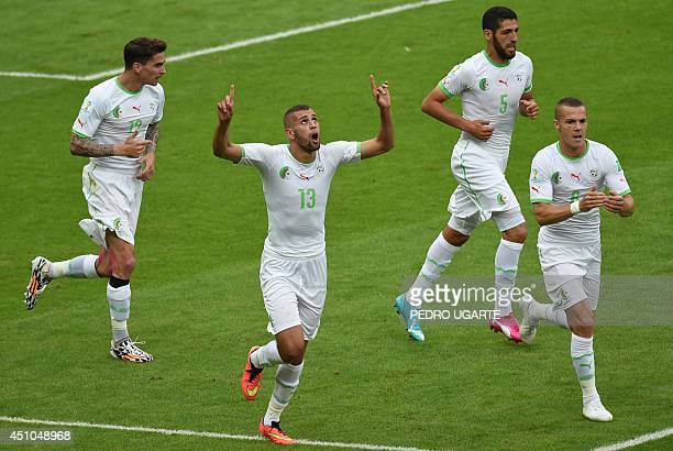 Algeria's forward Islam Slimani celebrates scoring during a Group H football match between South Korea and Algeria at the BeiraRio Stadium in Porto...