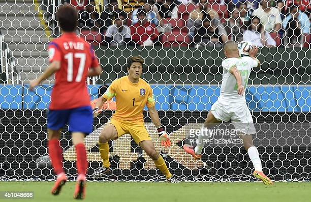Algeria's forward Islam Slimani faces South Korea's goalkeeper Jung SungRyong during a Group H football match between South Korea and Algeria at the...