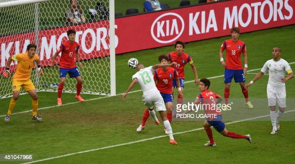 Algeria's forward Islam Slimani heads the ball in an attempt to score during the Group H football match between South Korea and Algeria at the...