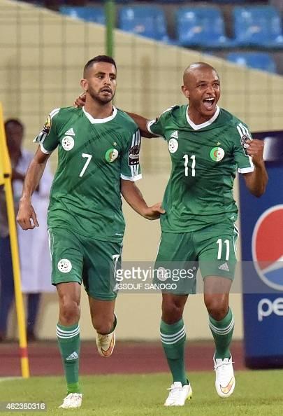 Algeria's forward Riyad Mahrez and Algeria's midfielder Yacine Brahimi celebrate their team's second goal during the 2015 African Cup of Nations...