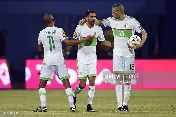 Algeria's forward Riyad Mahrez celebrates with Algeria's midfielder Yacine Brahimi and Algeria's forward Islam Slimani after scoring a second goal...