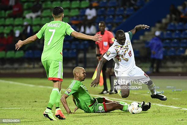 Algeria's forward Riyad Mahrez reacts as Senegal's defender Saliou Ciss challenges Algeria's midfielder Adlene Guedioura during the 2017 Africa Cup...