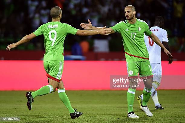 Algeria's forward Sofiane Hanni and Algeria's midfielder Adlene Guedioura celebrate a goal during the 2017 Africa Cup of Nations group B football...