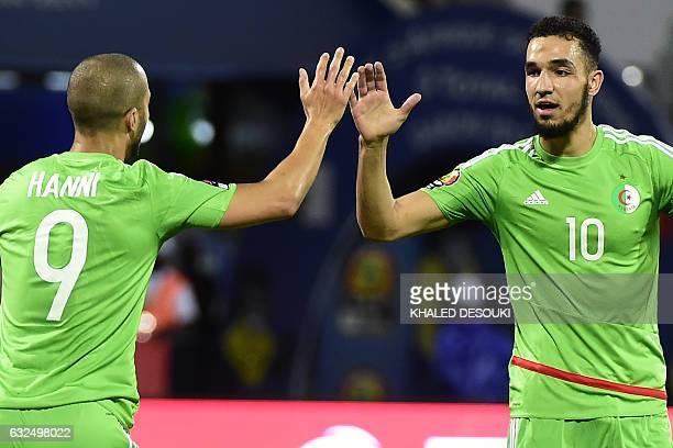 Algeria's forward Sofiane Hanni and Algeria's midfielder Nabil Bentaleb celebrate a goal during the 2017 Africa Cup of Nations group B football match...