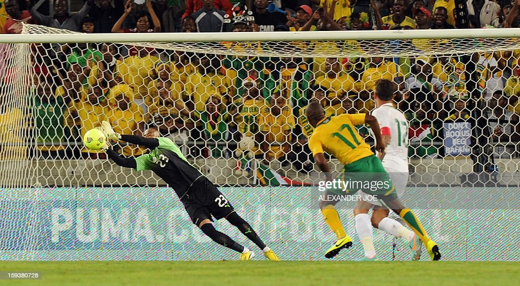 Algeria's goalkeeper Cedric si Mohammed stops a ball from South Africa's Bernard Parker during a friendly football match between South Africa's Bafana Bafana and Algeria in Soweto on January 12, 2013, ahead of the 2013 African Cup of nations that will take place in South Africa from January 19 to February 10.
