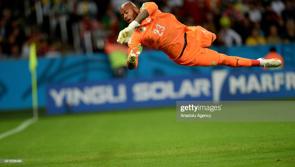 Algeria's goalkeeper Rais Mbolhi in action during the 2014 FIFA World Cup Brazil Round of 16 match between Germany and Algeria at Estadio Beira-Rio on June 30, 2014 in Porto Alegre, Brazil.