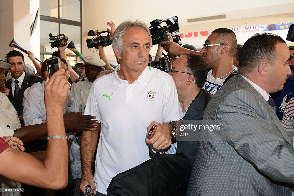 Algeria's head coach Vahid Halilhodzic (C) arrives at Ouagadougou Airport in Burkina Faso on October 10, 2013, ahead of the 2014 World Cup qualifying football match between Burkina Faso and Algeria on October 12.