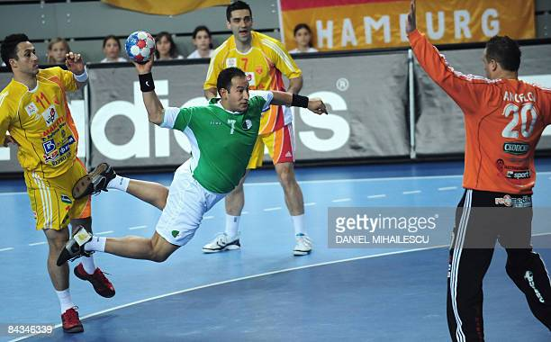 Algeria's Hichem Boudrali shoots between Velko Markoski and Vladimir Temelkov from Macedonia against Macedonia's goalkeeper Petar Angelov during the...