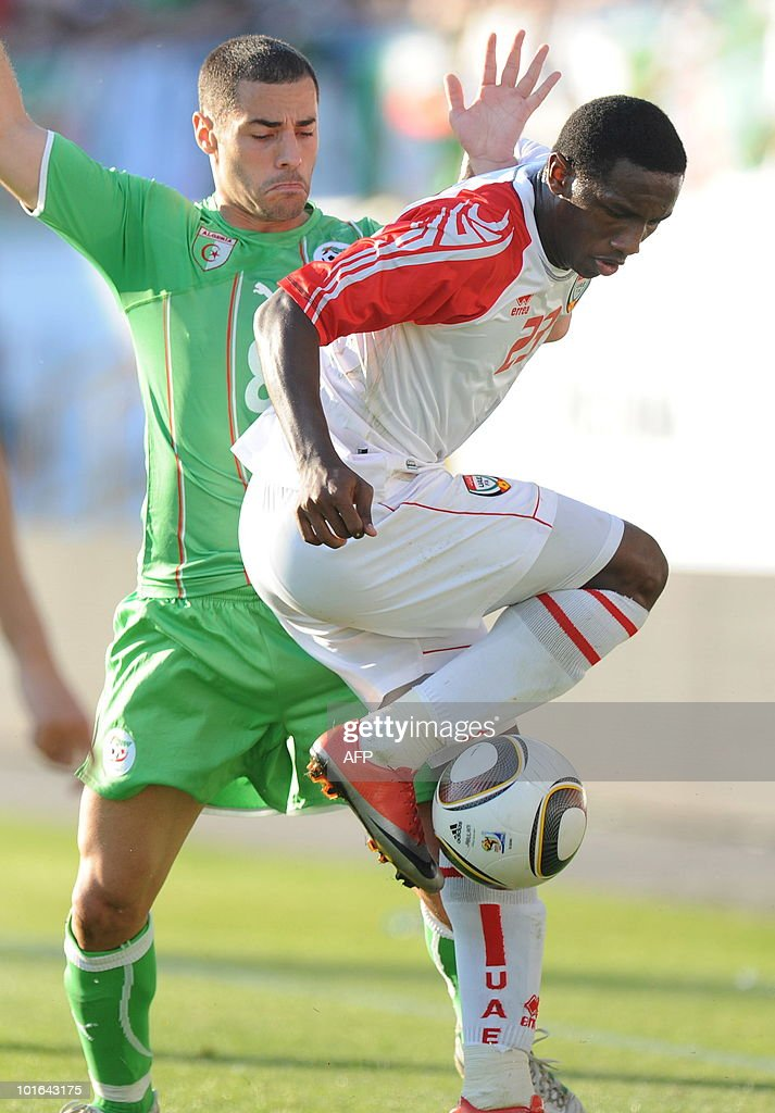 Algeria's Lacen Medhi (L) and Emirates Ahmed Khalil (R) challenge for the ball during a friendly football match between Algeria and the United Arab Emirates in Fuerth, southern Germany, June 5, 2010.